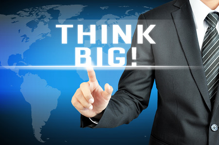 eagerness: Businessman hand touching THINK BIG message on virtual screen Stock Photo