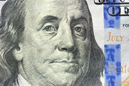 benjamin franklin: Close up of Benjamin Franklin face on 100 US dollar bill Stock Photo