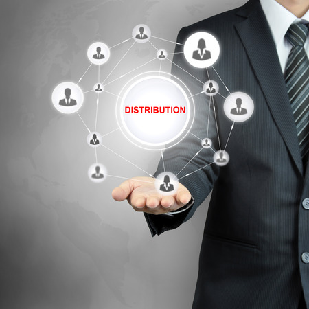 distributor: DISTRIBUTION sign with people icon network on businessman hand Stock Photo