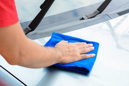 bonnet: A man hand cleaning car bonnet with microfiber cloth Stock Photo
