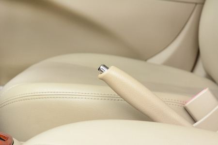 hand brake: Car hand brake lever near driver seat - beige color
