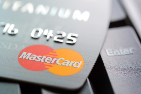 mastercard: Credit card with MasterCard logo on computer keyboard. MasterCard is an American multinational financial services corporation headquartered in New York, United States Editorial