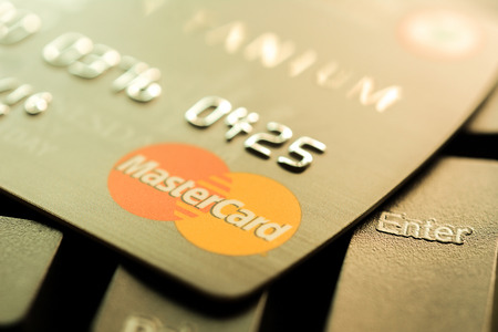 mastercard: Bangkok, Thailand - Jun 23, 2015 : Credit card with MasterCard logo on computer keyboard. MasterCard is an American multinational financial services corporation headquartered in New York, United States