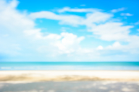 blue clouds: Blurred white sand beach and blue sky for background