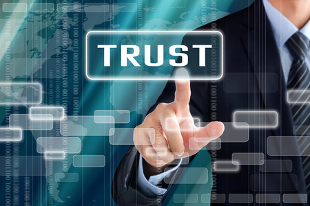 trust people: Businessman hand touching TRUST sign on virtual screen
