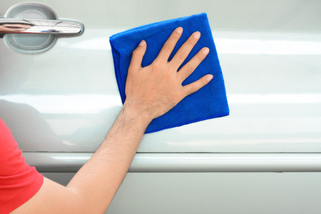 valeting: A man cleaning car with microfiber cloth Stock Photo