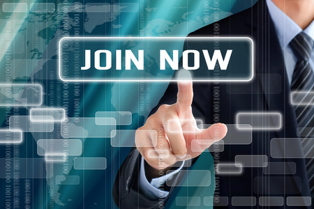 join hand: Businessman hand touching JOIN NOW sign on virtual screen