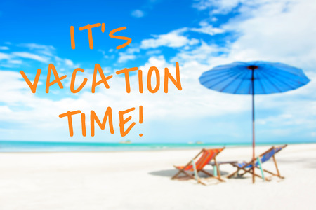 beach holiday: ITS VACATION TIME message on blurred beach background