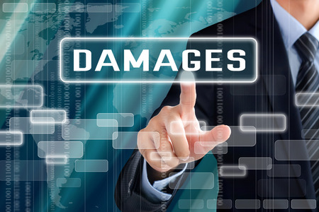 compensate: Businessman hand touching DAMAGES sign on virtual screen