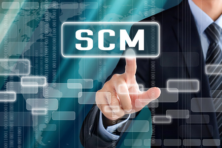 retail chain: Businessman hand touching SCM (or Supply Chain Management) sign on virtual screen