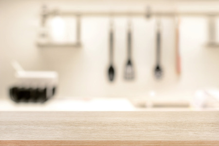 Wood table top on blur kitchen background - can be used for display or montage your products Standard-Bild