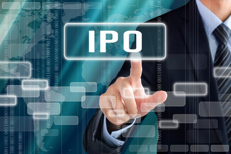 public offering: Businessman hand touching IPO (or Initial Public Offering ) sign on virtual screen Stock Photo
