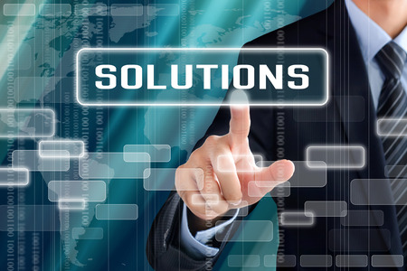 hands solution: Businessman hand touching SOLUTIONS sign on virtual screen