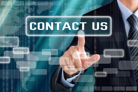 contact us sign: Businessman hand touching CONTACT US sign on virtual screen