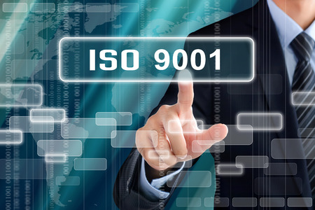 Businessman hand touching ISO9001 sign on virtual screen Stok Fotoğraf - 43369257