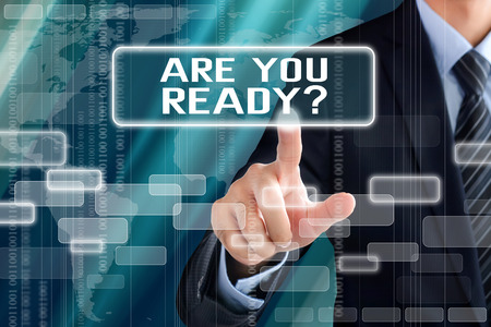 Businessman hand touching ARE YOU READY text on virtual screen Stock Photo