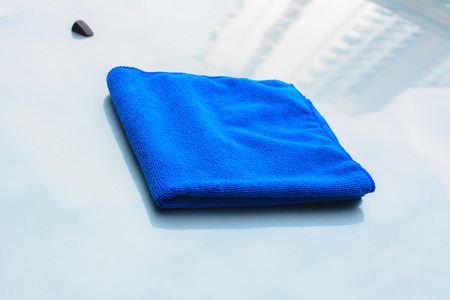 microfiber: Blue microfiber cleaning cloth on car bonnet