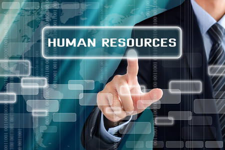 Businessman hand touching HUMAN RESOURCES sign on virtual screen Banco de Imagens