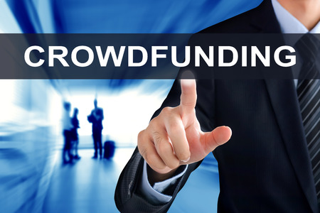 business funds: Businessman hands touching CROWDFUNDING tab on virtual screen Stock Photo