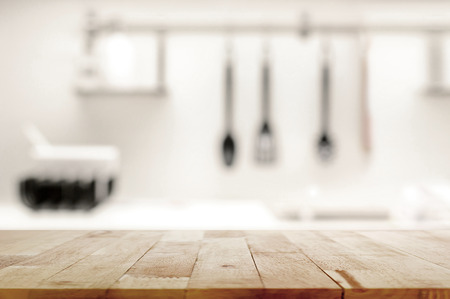 Wood table top on blur kitchen background - can be used for display or montage your products Foto de archivo