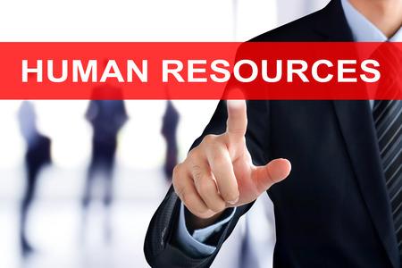 gestion empresarial: RECURSOS HUMANOS tocar Empresario mano (o HR) señal en la pantalla virtual Foto de archivo