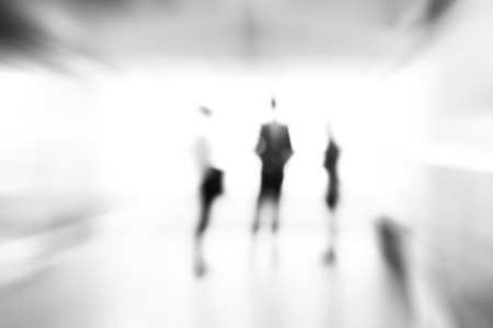 monocrome: Blur monocrome abstract background of business people standing in building hall Stock Photo