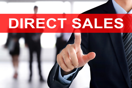 selling points: Businessman hand touching DIRECT SALES sign on virtual screen