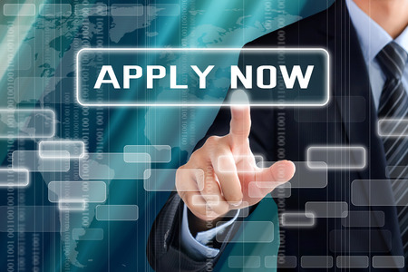 Businessman hand touching APPLY NOW tab on virtual screen