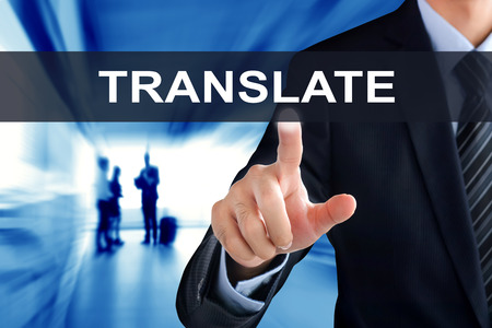 to interpret: Businessman hand touching TRANSLATE sign on virtual screen Stock Photo