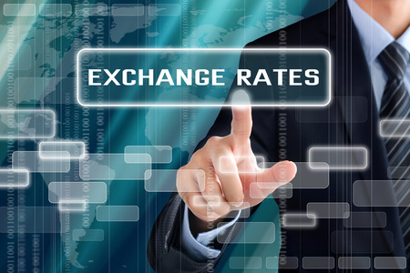 economic: Businessman hand touching EXCHANGE RATES tab on virtual screen