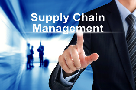 retail chain: Businessman hand touching Supply Chain Management (or SCM) text on virtual screen