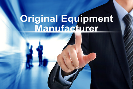 modern manufacturing: Businessman hand touching Original Equipment Manufacturer (or OEM) text on virtual screen Stock Photo