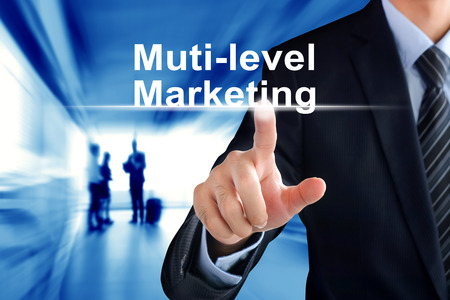 passive income: Businessman hand touching Multi-level Marketing (or MLM) text on virtual screen