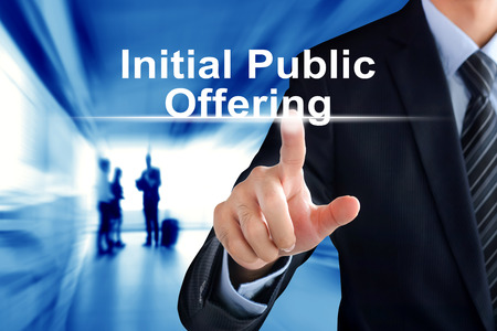 initial public offerings: Businessman hand touching Initial Public Offering (or IPO) sign on virtual screen Stock Photo