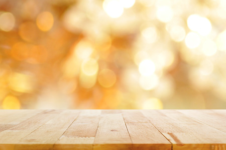 Wood table top on blur bokeh golden background - can be used for display and montage your products