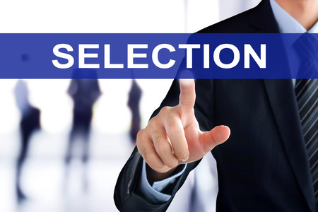 selection: Businessman hand touching SELECTION tab on virtual screen