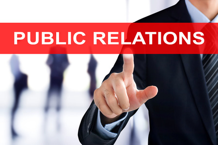 relations: Businessman hand touching PUBLIC RELATIONS sign on virtual screen