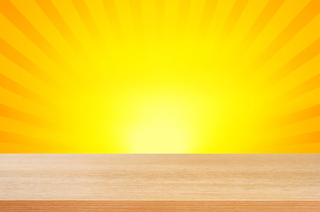 radiate: Wood table top on yellow and orange radiate (sunburst) background - can be used for display or montage your products