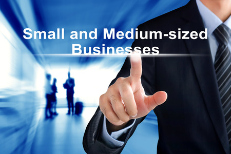 company person: Businessman hand touching Small and Medium-sized Businesses (or SMB) sign on virtual screen