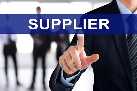 touch screen: Businessman hand touching SUPPLIER sign on virtual screen