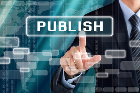 publish: Businessman hand touching PUBLISH sign on virtual screen