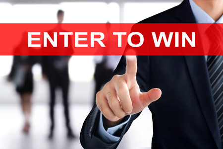 to win: Businessman hands touching ENTER TO WIN tab on virtual screen
