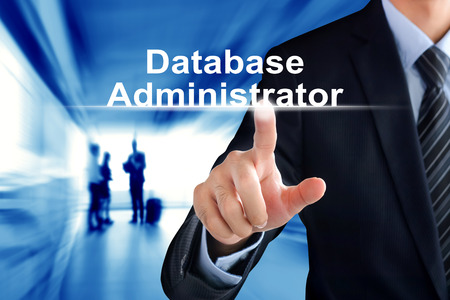 Businessman hand touching Database Administrator (or DBA) text on virtual screen