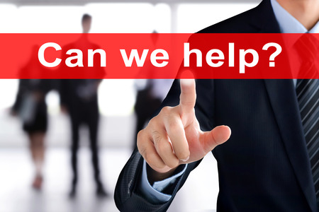 can we help: Businessman touching  Can we help? sign on virtual screen