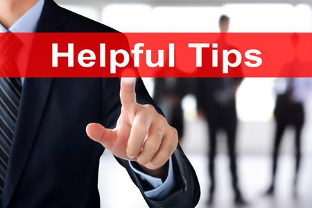 tab: Businessman hand touching Helpful Tips tab on virtual screen Stock Photo