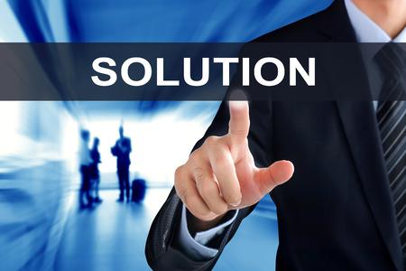 tab: Businessman hand touching SOLUTION  tab on virtual screen