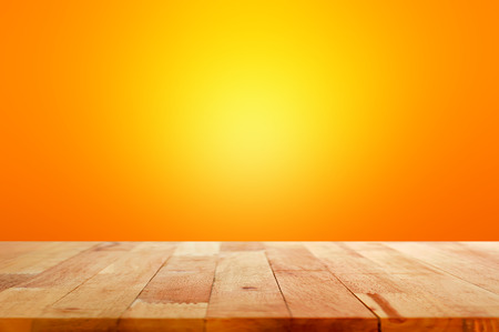Wood table top on gradient orange background - can be used for display or montage your products