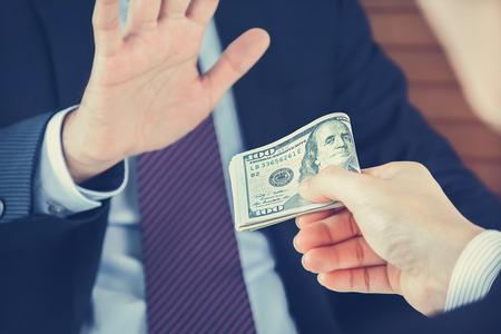 refusing: Businessman refusing money, uncorrupted concept - soft focused Stock Photo