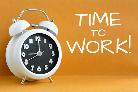 o'clock: TIME to WORK text on retro brown background with alarm clock showing 9 oclock Stock Photo