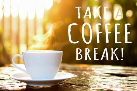 take a break: TAKE A COFFEE BREAK text with coffee cup in blur bokeh of morning sunlight background Stock Photo